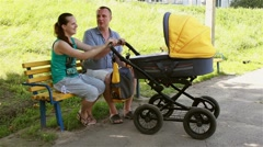 happy family rocking baby in stroller - stock footage