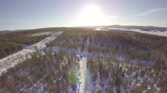Aerial view of a country winter road through the forest - Sweden Stock Footage