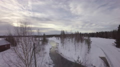 Aerial view of watercourse with clear water and frozen lake - Sweden Stock Footage