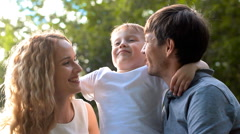 Father, mother and son having fun in the park Stock Footage