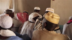 Africa native village men praying in islamic church Stock Footage