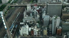 Tokyo - Aerial city view with highway traffic and trains. 4K resolution - stock footage