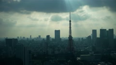 Tokyo - Aerial city view with clouds and beams of evening light. 4K resolution Stock Footage