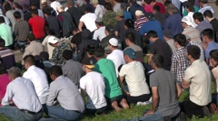 Muslims prayers on celebration of Eid al-Fitr (Uraza-Bairam). Crowd of migrants Stock Footage
