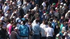 Muslims prayers on celebration of Eid al-Fitr (Uraza-Bairam). Crowd of migrants Stock Footage
