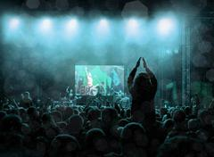 Rock concert, silhouettes of happy people raising up hands Kuvituskuvat