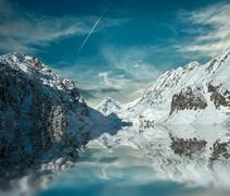 Beautiful mountains view with reflex at winter under sky. - stock photo