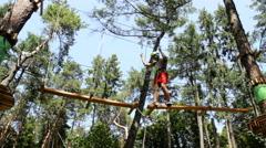 Man climbing in Adventure Park Stock Footage