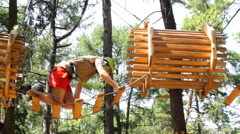 Man climbing in Adventure Park Stock Footage