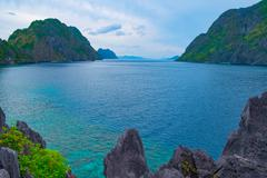 Scenic view of sea bay and mountain islands - stock photo