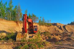 Excavator working in sand quarry Stock Photos