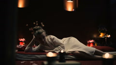 The woman lies on a massage table. Stock Footage