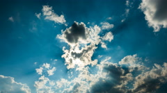 Sun with clouds in blue sky, time-lapse Stock Footage