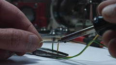4k technical composition of a soldering iron and wires Stock Footage