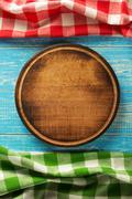 pizza cutting board on wood - stock photo