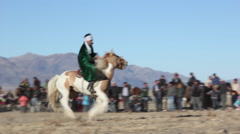 FESTIVAL HORSEMAN KAZAKH PICK UP GAME Stock Footage