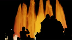 Recognizable silhouettes of people in singing fountain in Barcelona. People Stock Footage