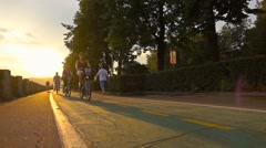 RUSSIA, MOSCOW-July, 3. Slow motion sunset shot of bicyclers on city rental Stock Footage
