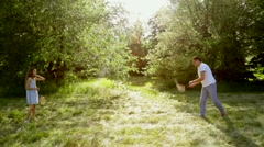 Father and Child, Little Girl Playing Badminton on Meadow Stock Footage