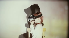 Little girl using 3D Virtual Reality headset Stock Footage