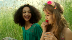Young girls eating strawberry and cheering - stock footage