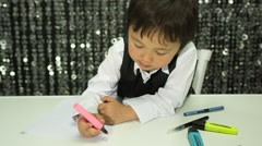 Boy child kid draw design crayons Stock Footage