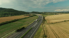 Aerial Shot of Highway in Rural Area in Bright Sunny Day Stock Footage