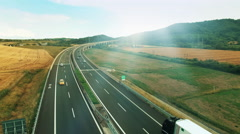 Aerial Shot of Highway with Intersections in Rural Area in Bright Sunny Day Stock Footage