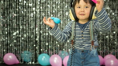 Boy child party balloons Stock Footage
