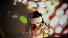 Little girl using VR-helmet. vr dance simulator Stock Footage