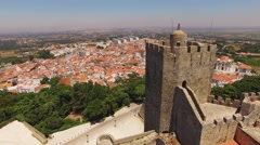 Tower of Medieval Castelo de Palmela on the background of the city aerial view Stock Footage