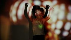 Little boy dancing in the spotlight - stock footage