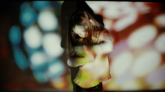 Little girl dancing in the spotlight - stock footage