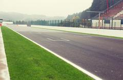close up of speedway track or road and stands - stock photo
