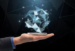 close up of hand with projection and smartphone - stock photo