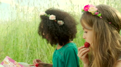 Young girls eating strawberry and cheering Stock Footage