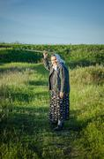 Grandmother the pensioner on walk Stock Photos