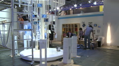 Preparation of a Business commerce technology fair - stock footage