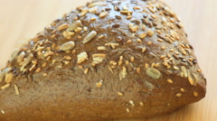Hot rye bread with sunflower seeds and black sesame Stock Footage
