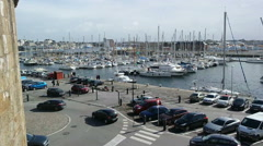 Cars driving on road near a sea port SAINT-MALO, FRANCE  Stock Footage