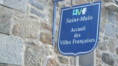 Stone wall with sign in Saint-Malo Stock Footage