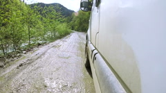 Lorry goes on  dirt dirty road after rain near  river. POV clip Stock Footage