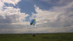 Paragliding Instructor and Student. Training on the Ground With Open Wings. Stock Footage