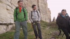 4K Group of rock climbers hiking to location to begin a climb Stock Footage