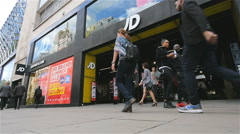 Oxford Street shoppers passing the JD Sports shop front, London, UK Stock Footage