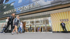 Oxford Street shoppers passing the Marks & Spencer department store, London, UK Stock Footage