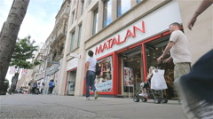 Oxford Street shoppers passing the Matalan fashion store, London, UK - stock footage