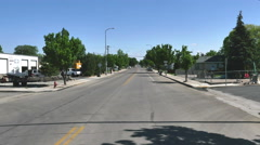 POV-Driving main street small rural Utah town Stock Footage