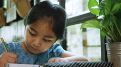 4K : Little Asian child doing her exercise workbook, Education concept Stock Footage