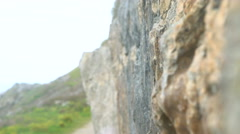 4K Close up of male rock climber gripping on to vertical rock face Stock Footage